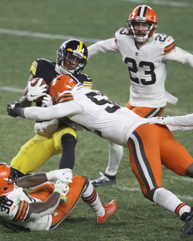 Jan 10, 2021; Pittsburgh, PA, USA; Pittsburgh Steelers wide receiver Ray-Ray McCloud (14) is tackled by Cleveland Browns running back D'Ernest Johnson (30) and outside linebacker Elijah Lee (52) in the fourth quarter of an AFC Wild Card playoff game at Heinz Field. Mandatory Credit: Charles LeClaire-USA TODAY Sports