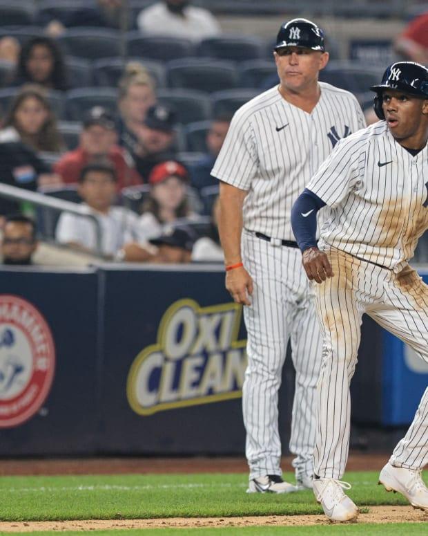Yankees OF Greg Allen leading off third base