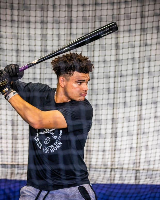 Ian Moller practices at Built Not Born Baseball facility Monday, Aug. 17, 2020 in Dubuque, Iowa. Moller has spent the summer traveling to showcase his talents in baseball and is projected is to be a possible first round draft pick next year. His family owns the facility and they have transformed the garage into a space to hit, lift weights, practice catching, and watch video.