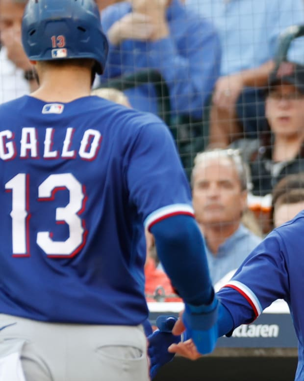 Jul 21, 2021; Detroit, Michigan, USA; Texas Rangers center fielder Joey Gallo (13) receives congratulations from shortstop Eli White (41) after scoring in the second inning against the Detroit Tigers at Comerica Park.