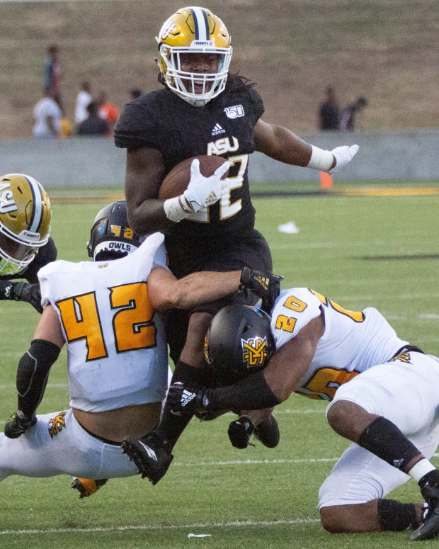 Bryson Armstrong (No. 42) assisting on a tackle.
