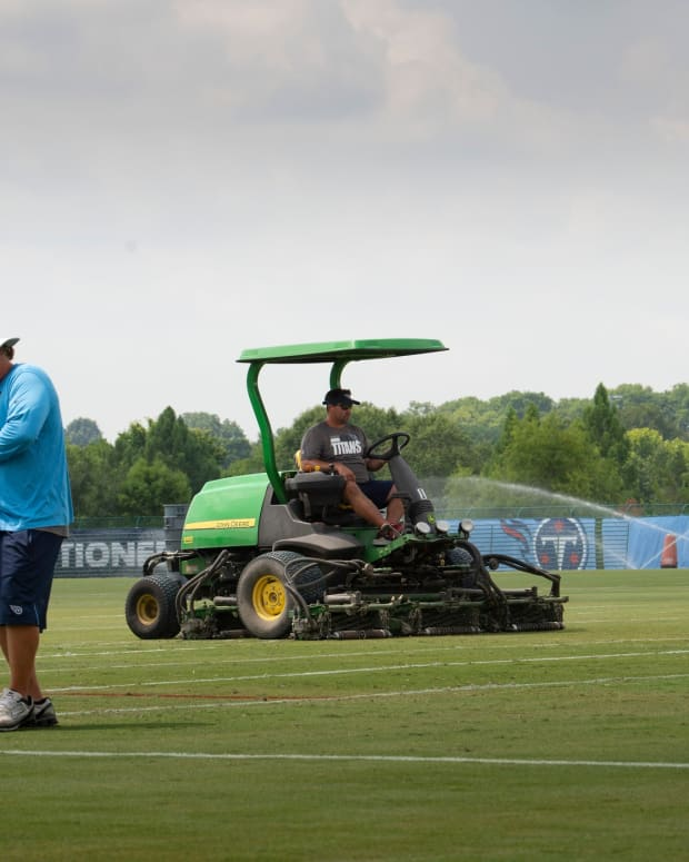 Members of the Titans ground crew prepare the practices fields for the start of training camp at Saint Thomas Sports Park Tuesday, July 27, 2021 in Nashville, Tenn. The Titans hold their first training camp practices on Wednesday.