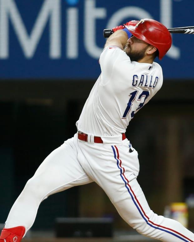 Jul 27, 2021; Arlington, Texas, USA; Texas Rangers right fielder Joey Gallo (13) hits a three run home run in the fourth inning against the Arizona Diamondbacks at Globe Life Field.