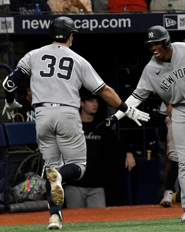 Yankees Ryan LaMarre and Greg Allen celebrate
