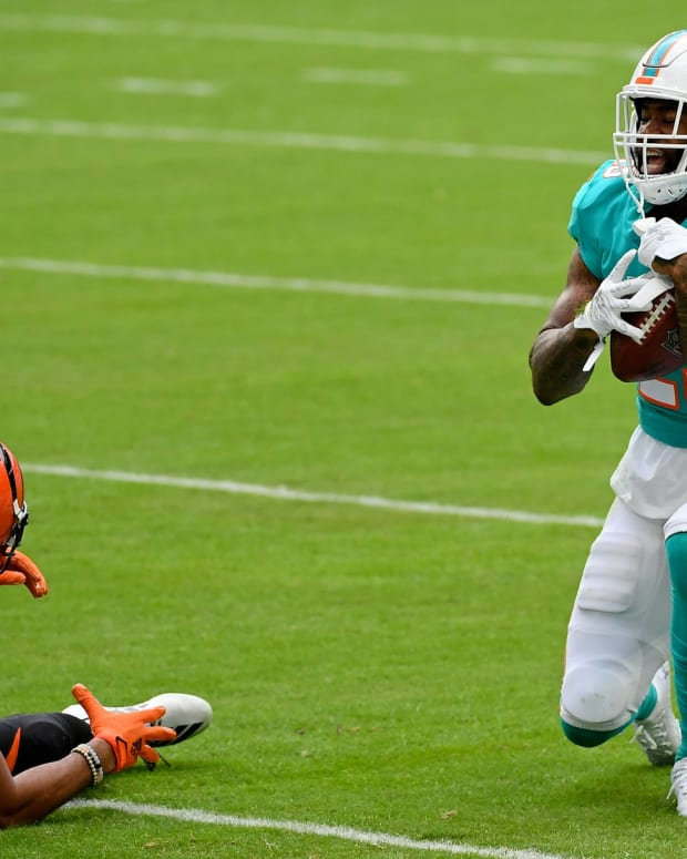 Dec 6, 2020; Miami Gardens, Florida, USA; Miami Dolphins cornerback Xavien Howard (25) celebrates after intercepting the pass intended for Cincinnati Bengals wide receiver Tyler Boyd (83) during the first half at Hard Rock Stadium. Mandatory Credit: Jasen Vinlove-USA TODAY Sports