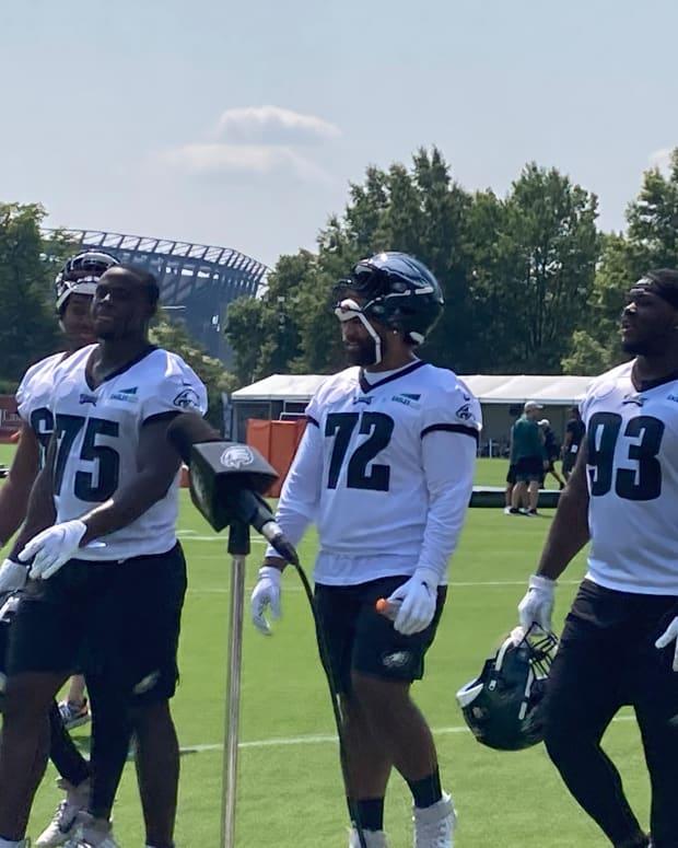 Eagles rookie defensive lineman Tarron Jackson (75), Marlon Tuipulotu, and Milton Williams leave the pratice field on July 27, 2021