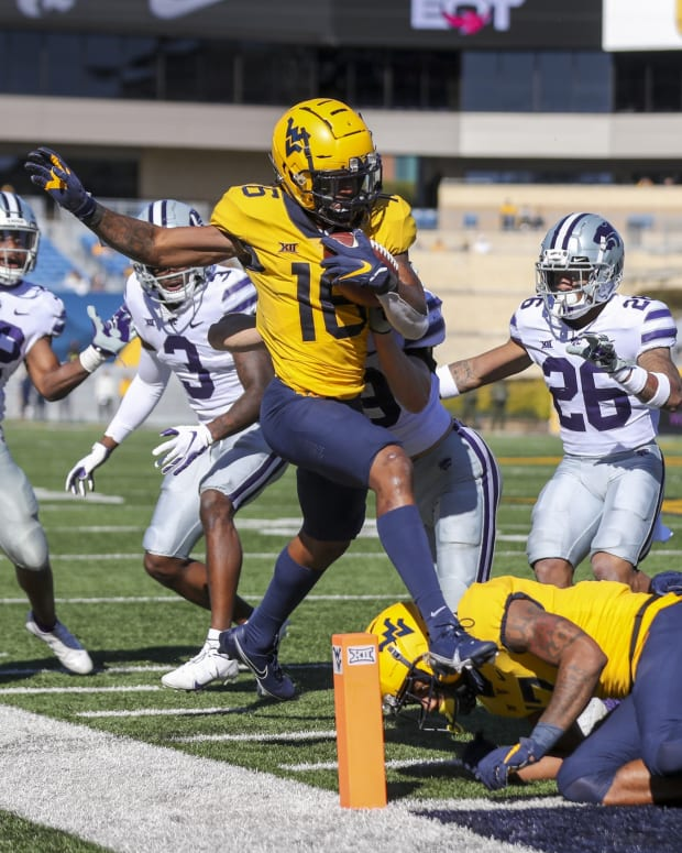 Oct 31, 2020; Morgantown, West Virginia, USA; West Virginia Mountaineers wide receiver Winston Wright Jr. (16) makes a catch and runs for a touchdown during the second quarter against the Kansas State Wildcats at Mountaineer Field at Milan Puskar Stadium.