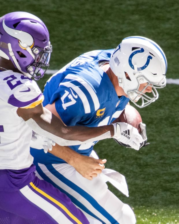 Sep 20, 2020; Indianapolis, Indiana, USA; Indianapolis Colts quarterback Philip Rivers (17) is tackled by Minnesota Vikings defensive back Holton Hill (24) in the game at Lucas Oil Stadium.