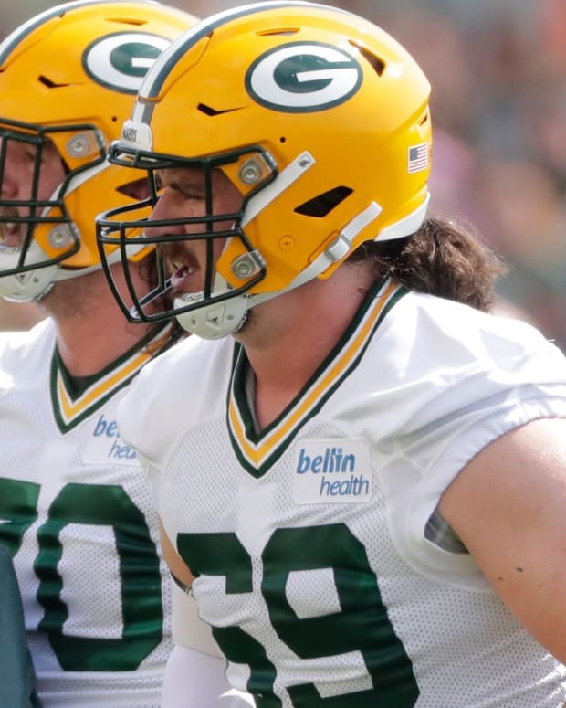 Green Bay Packers offensive guard Royce Newman (70) and tackle Dennis Kelly (69) participate in training camp Thursday, July 29, 2021, in Green Bay, Wis.