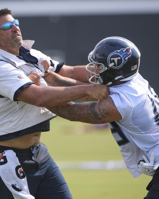 Tennessee Titans linebacker Justin March (45) works with Tennessee Titans head coach Mike Vrabel during training camp at Saint Thomas Sports Park.
