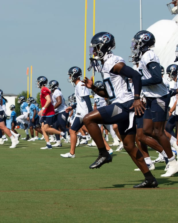 Tennessee Titans warm up before a training camp practice at Saint Thomas Sports Park Friday, July 30, 2021 in Nashville, Tenn.