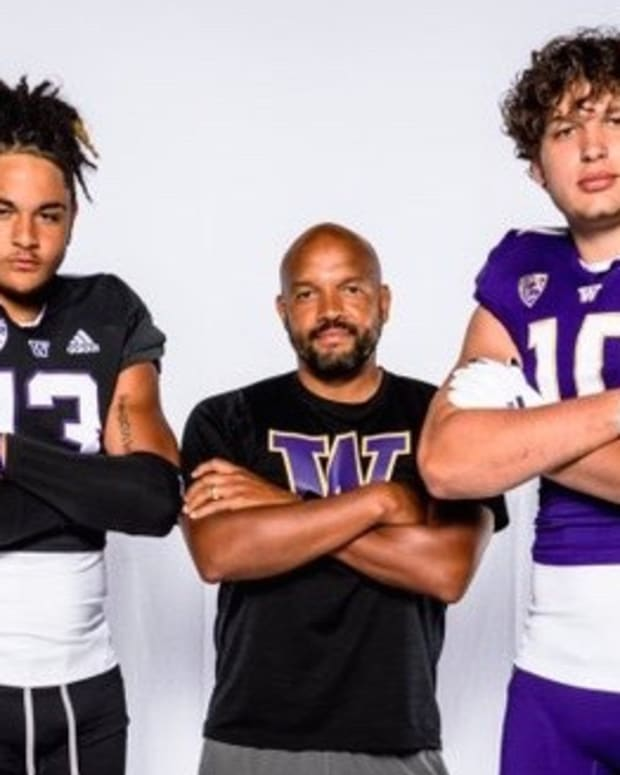 Tight-end commits Chance Bogan and Ryan Otton flank UW coach Jimmy Lake.