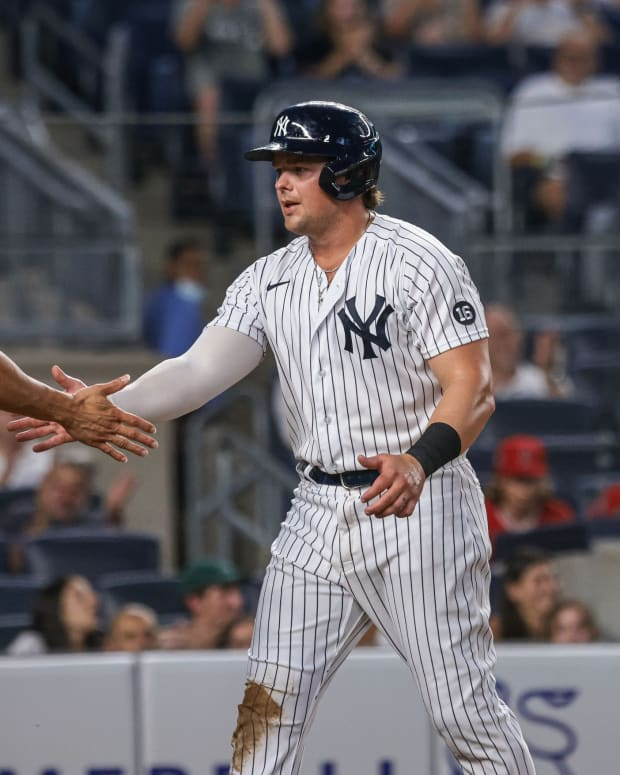 Yankees 1B Luke Voit shakes hands with Giancarlo Stanton