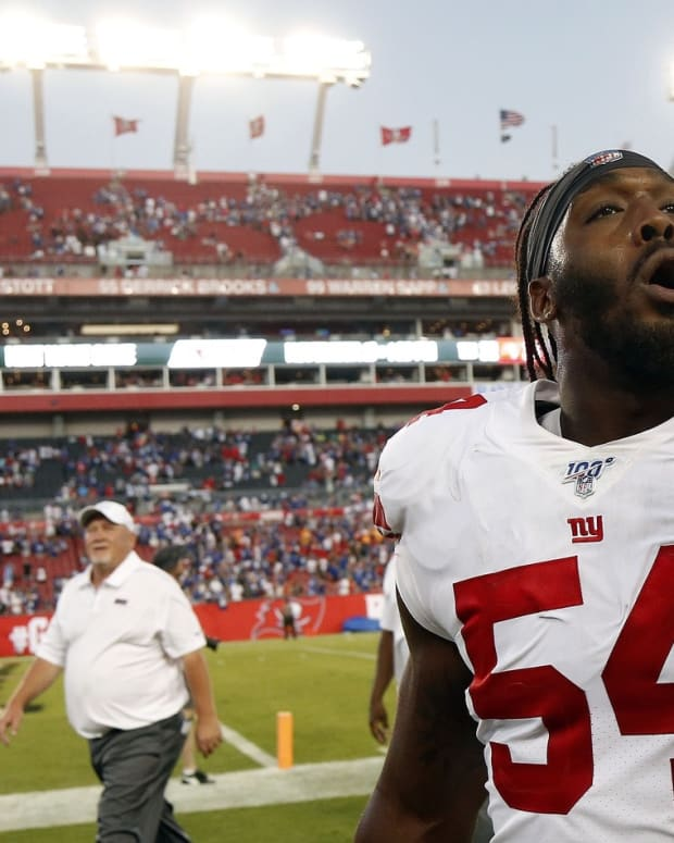 New York Giants linebacker Tuzar Skipper (54) celebrates after defeating the Tampa Bay Buccaneers at Raymond James Stadium.
