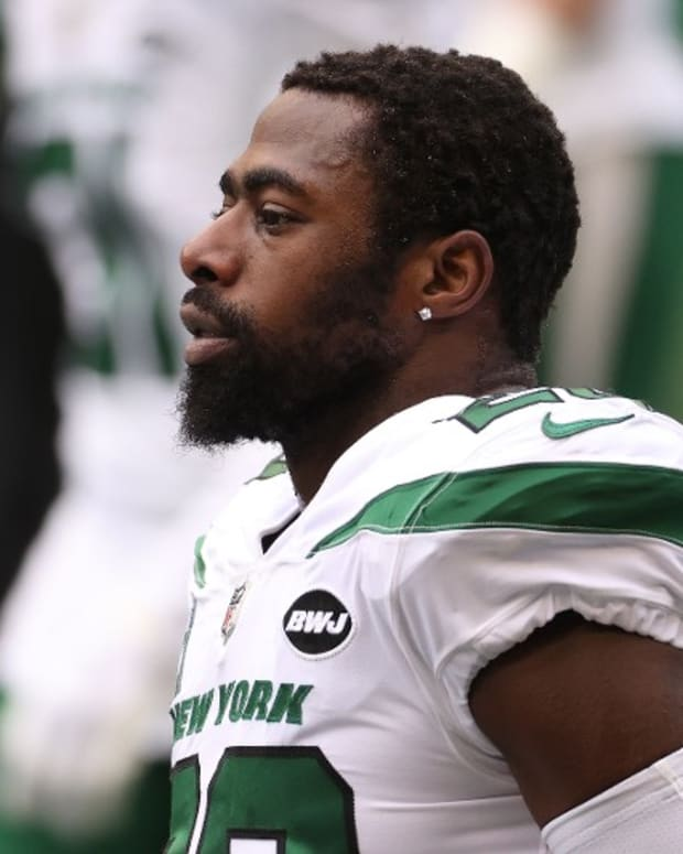 Jets safety Marcus Maye looks on from sideline
