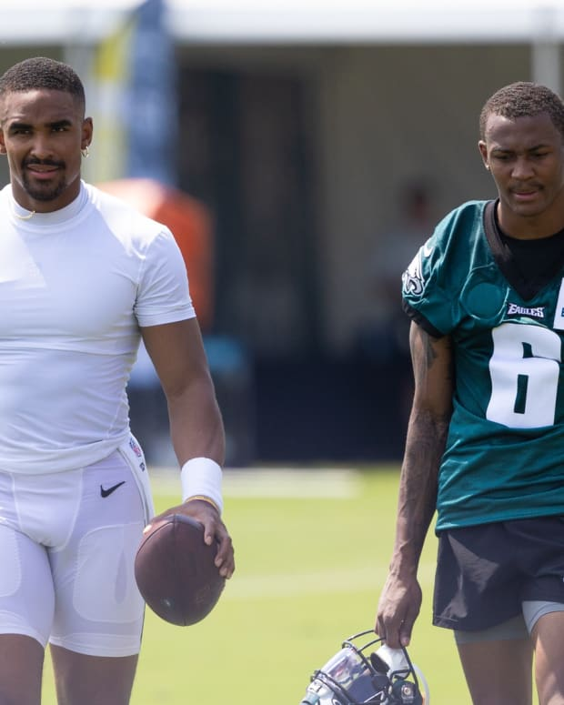 Jalen Hurts (left) and DeVonta Smith leave the field after a recent Eagles training camp practice