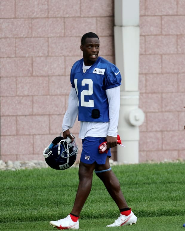 Giants wide receivers John Ross (12) and Derrick Dillon are shown as they walk off the practice field, in East Rutherford.