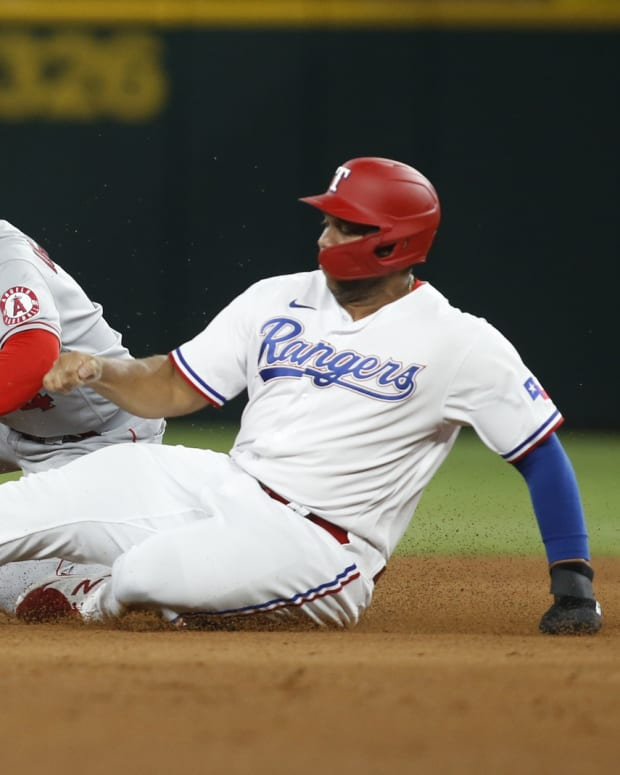 Aug 2, 2021; Arlington, Texas, USA; Texas Rangers designated hitter Curtis Terry (83) avoids the tag of Los Angeles Angels shortstop Jose Iglesias (4) at second base in the eighth inning at Globe Life Field.