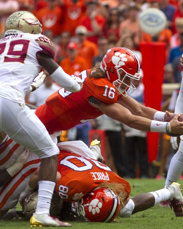 Clemson Tigers quarterback Trevor Lawrence (16) dives for a touchdown during the first quarter of the game against the Florida State Seminoles at Clemson Memorial Stadium.
