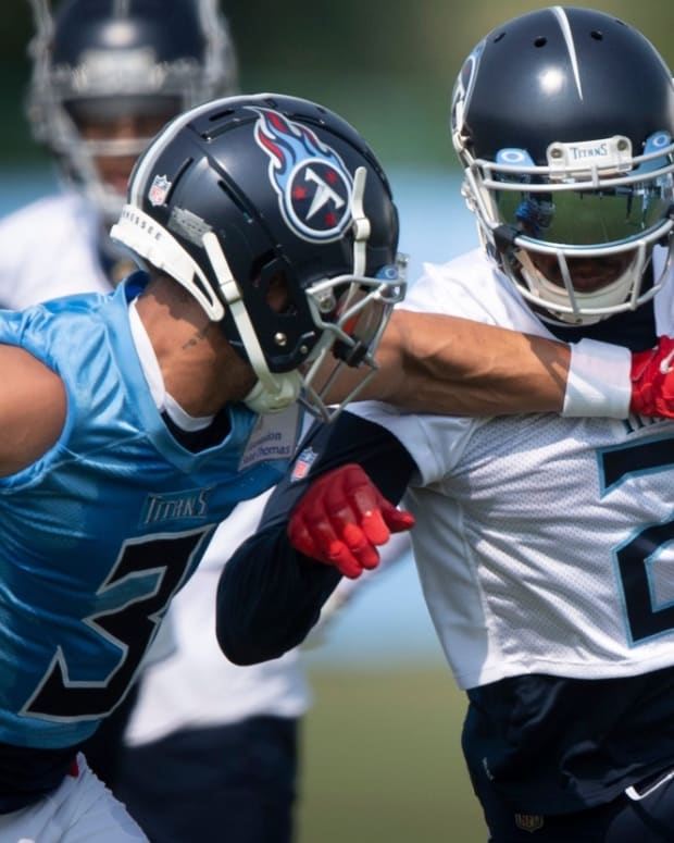 Tennessee Titans cornerback Caleb Farley (3) defends wide receiver Julio Jones (2) during a training camp practice at Saint Thomas Sports Park Monday, Aug. 2, 2021 in Nashville, Tenn.