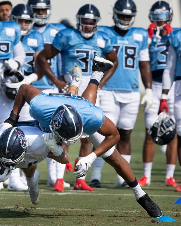 Tennessee Titans outside linebacker Rashad Weaver (99) drives fullback Tory Carter (44) to the ground in tackling drills during a training camp practice at Saint Thomas Sports Park Tuesday, Aug. 3, 2021 in Nashville, Tenn.