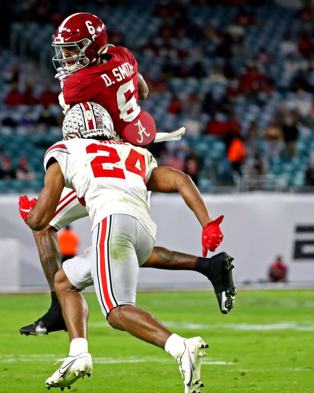 Jan 11, 2021; Miami Gardens, Florida, USA; Alabama Crimson Tide wide receiver DeVonta Smith (6) makes a catch against Ohio State Buckeyes cornerback Shaun Wade (24) during the first quarter in the 2021 College Football Playoff National Championship Game.
