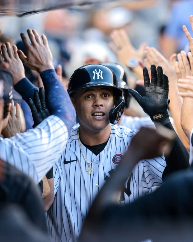 Yankees 3B Gio Urshela celebrates in dugout