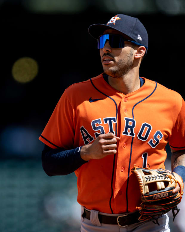 Jul 28, 2021; Seattle, Washington, USA; Houston Astros shortstop Carlos Correa (1) jogs off the field during a game against the Seattle Mariners at T-Mobile Park. The Astros 11-4.