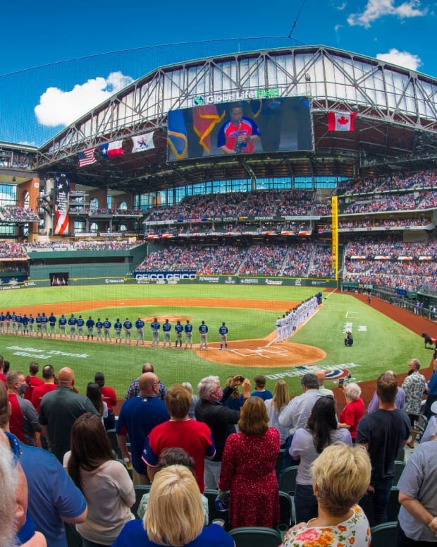 Apr 5, 2021; Arlington, Texas, USA; A view of the field and the fans and the ballpark and the players during the playing of US and Canadian national anthems before the game between the Texas Rangers and the Toronto Blue Jays at Globe Life Field.