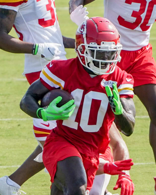 Jul 28, 2021; St. Joseph, MO, United States; Kansas City Chiefs wide receiver Tyreek Hill (10) runs the ball after a catch during training camp at Missouri Western State University. Mandatory Credit: Denny Medley-USA TODAY Sports