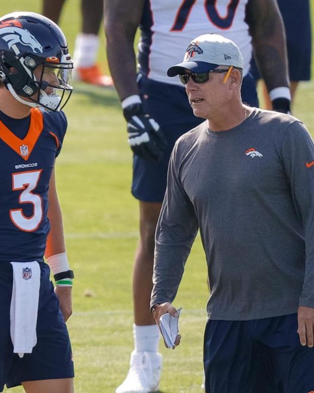 Denver Broncos quarterback Drew Lock (3) talks with offensive coordinator Pat Shurmur during training camp at UCHealth Training Center.