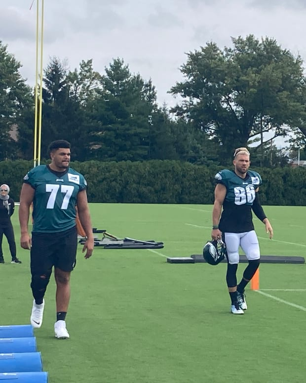 Andre Dillard (left) and Zach Ertz take the field to practice against the Patriots on Aug. 16, 2021