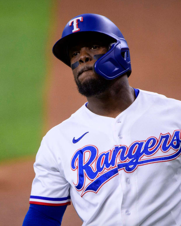 Aug 19, 2021; Arlington, Texas, USA; Texas Rangers right fielder Adolis Garcia (53) strikes out during the first inning against the Seattle Mariners at Globe Life Field.