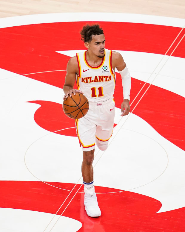 Atlanta Hawks guard Trae Young dribbles the ball at mid court against the Sacramento Kings