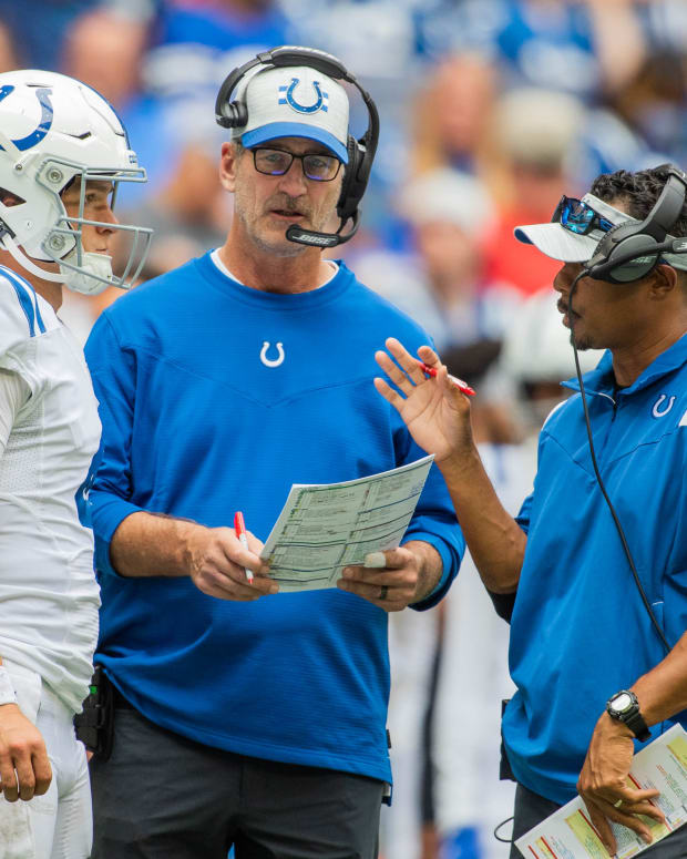 Aug 15, 2021; Indianapolis, Indiana, USA; Indianapolis Colts head coach Frank Reich (center) talks with quarterback Sam Ehlinger (4) during a timeout in the second half against the Carolina Panthers at Lucas Oil Stadium. Mandatory Credit: Trevor Ruszkowski-USA TODAY Sports