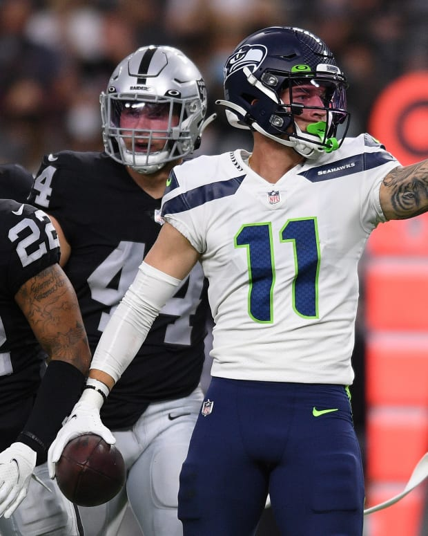 Seattle Seahawks wide receiver Cody Thompson (11) reacts after a first down against the Las Vegas Raiders during the first quarter at Allegiant Stadium.