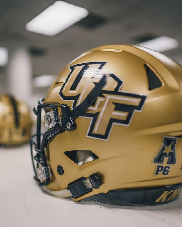 UCF Gold Helmets on Table