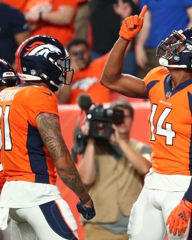 Denver Broncos wide receiver Courtland Sutton (14) celebrates after a touchdown catch against the Los Angeles Rams during the second quarter at Empower Field at Mile High.