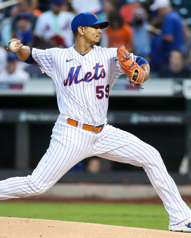 Sep 2, 2021; New York City, New York, USA; New York Mets pitcher Carlos Carrasco (59) pitches in the first inning against the Miami Marlins at Citi Field.