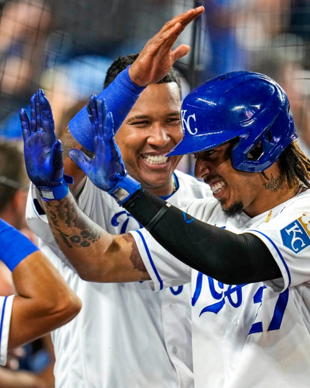 Sep 1, 2021; Kansas City, Missouri, USA; Kansas City Royals designated hitter Adalberto Mondesi (27) is congratulated by catcher Salvador Perez (13) and shortstop Nicky Lopez (8) after hitting a home run against the Cleveland Indians during the fourth inning at Kauffman Stadium. Mandatory Credit: Jay Biggerstaff-USA TODAY Sports