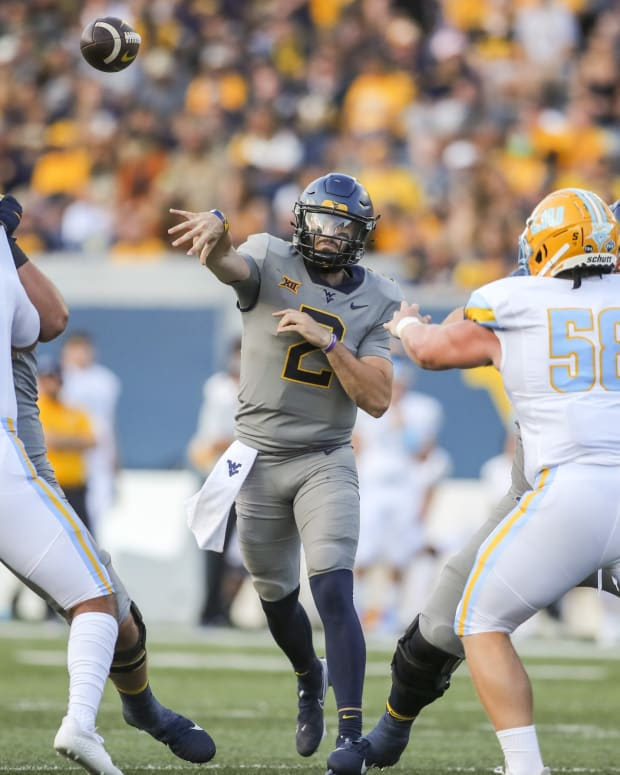 Sep 11, 2021; Morgantown, West Virginia, USA; West Virginia Mountaineers quarterback Jarret Doege (2) throws a pass against the Long Island Sharks during the second quarter at Mountaineer Field at Milan Puskar Stadium.