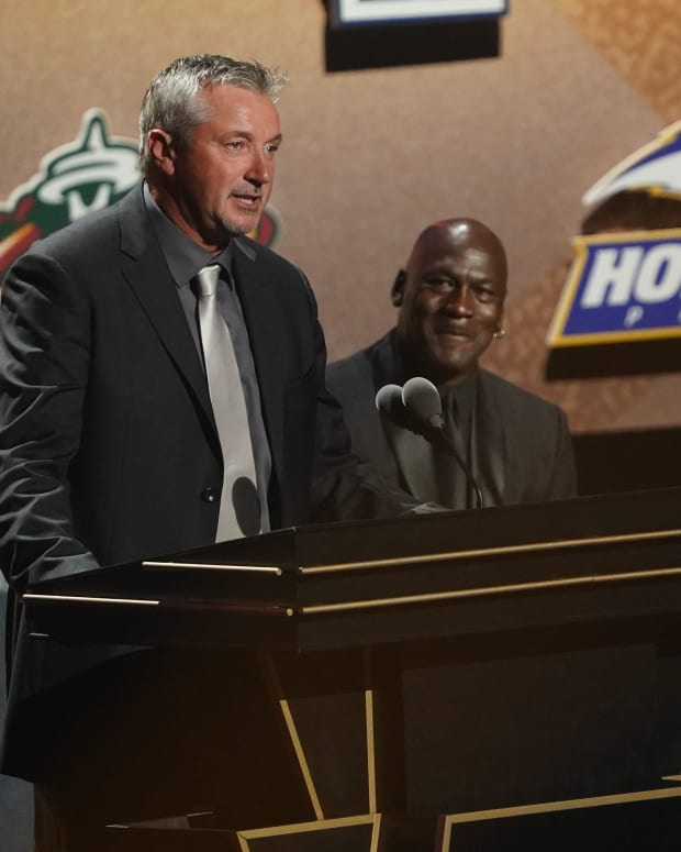 Class of 2021 inductee Toni Kukoc speaks alongside presenters Michael Jordan and Jerry Reinsdorf during the Naismith Memorial Basketball Hall of Fame Enshrinement at MassMutual Center.