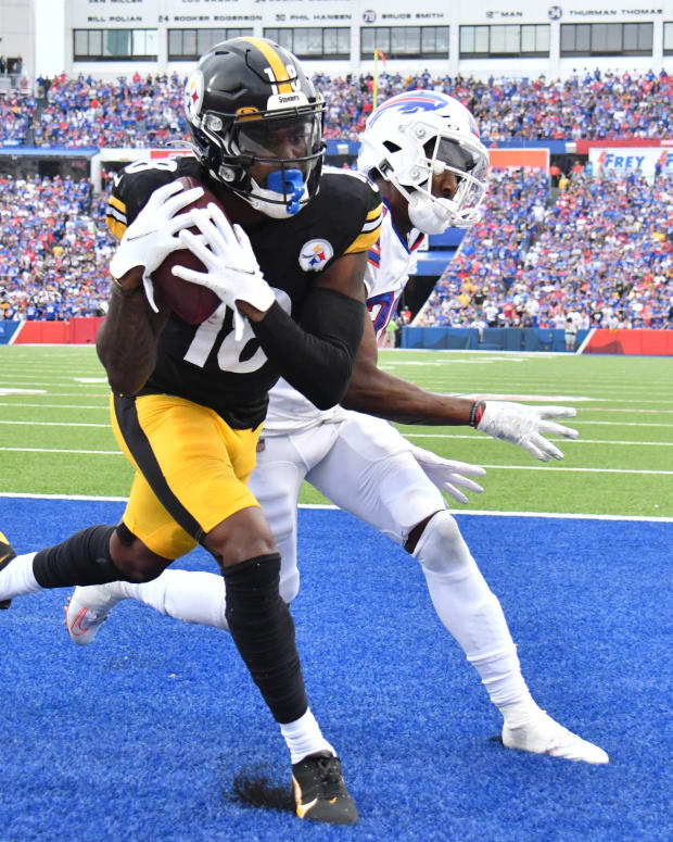 Sep 12, 2021; Orchard Park, New York, USA; Pittsburgh Steelers wide receiver Diontae Johnson (18) catches a touchdown as Buffalo Bills defensive back Levi Wallace (39) defends in the fourth quarter of a game at Highmark Stadium.