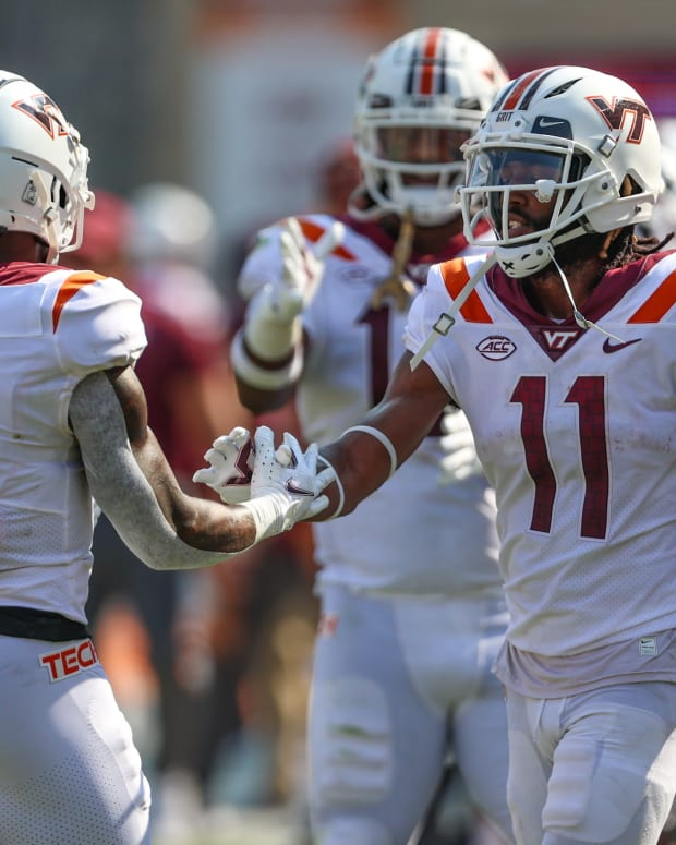 Sep 11, 2021; Blacksburg, Virginia, USA; Virginia Tech Hokies wide receiver Jalen Holston (0) celebrates with wide receiver Tr Turner (11) after a touchdown against Middle Tennessee Blue Raiders during the third quarter at Lane Stadium