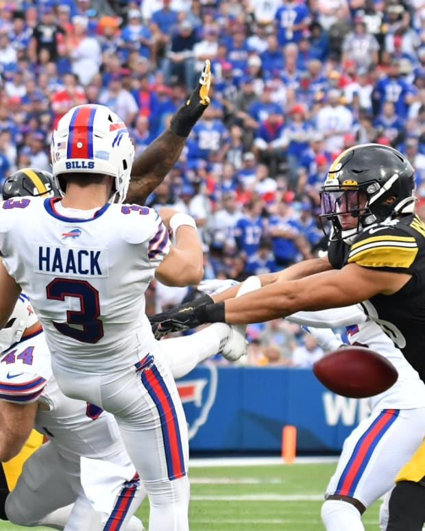 Steelers safety Miles Killebrew (28) blocks a punt by Buffalo Bills punter Matt Haack (3) in the fourth quarter of a game at Highmark Stadium.