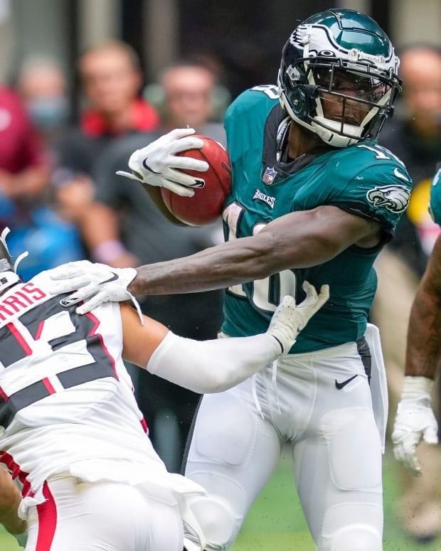 Sep 12, 2021; Atlanta, Georgia, USA; Philadelphia Eagles wide receiver Jalen Reagor (18) runs against Atlanta Falcons safety Erik Harris (23) during the second half at Mercedes-Benz Stadium.