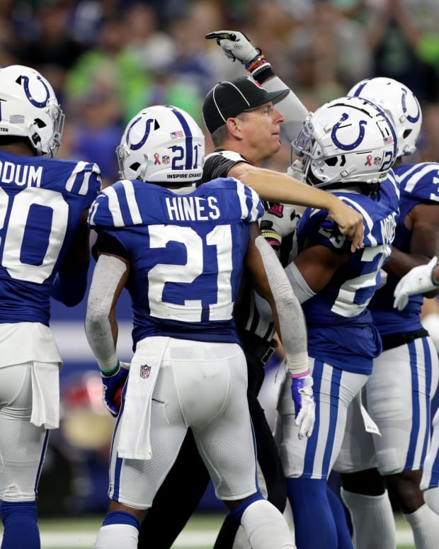 A referee helps separate Indianapolis Colts cornerback Kenny Moore II (23) and Seattle Seahawks linebacker Cody Barton (57) on Sunday, Sept. 12, 2021, during the regular season opener at Lucas Oil Stadium in Indianapolis.