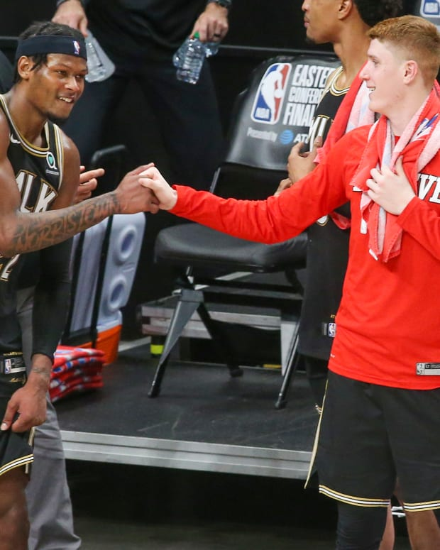 Atlanta Hawks forward Cam Reddish (22) celebrates with guard Kevin Huerter