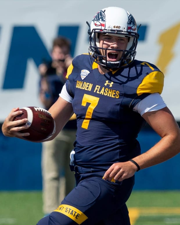 Kent State wins 60-10 in its home opener against Virginia Military Institute on Saturday, Sept. 11, 2021. Quarterback Dustin Crum scores in the first quarter on a keeper.