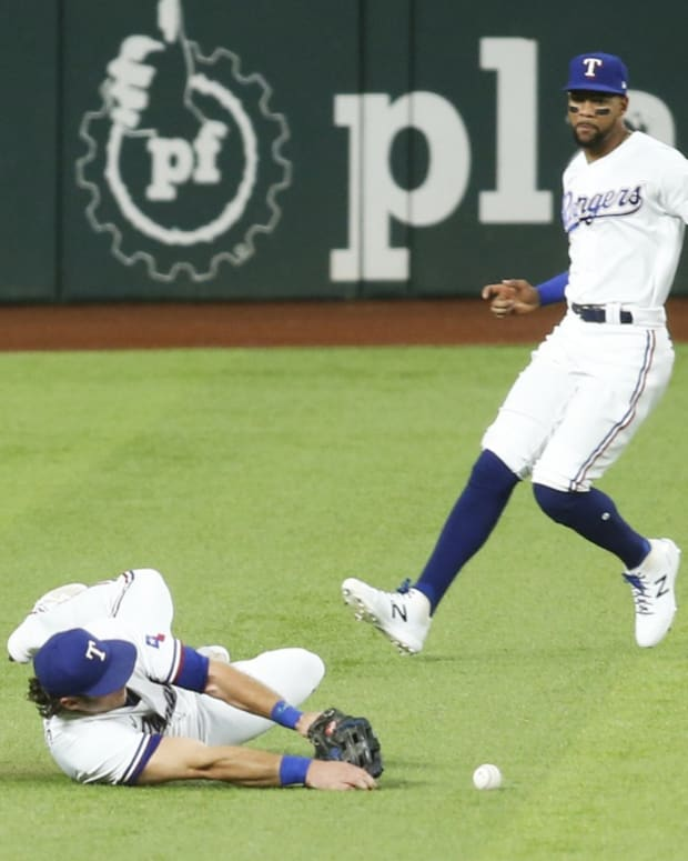Sep 13, 2021; Arlington, Texas, USA; Texas Rangers left fielder DJ Peters (38) cannot catch a ball hit by Houston Astros second baseman Jose Altuve (not pictured) in the first inning at Globe Life Field.